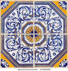 Traditional Portuguese azulejos, painted ceramic tilework by portumen, via Shutterstock