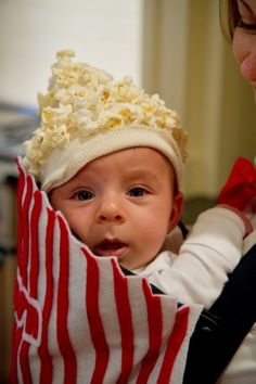 Very cute popcorn outfit/costume. Baby's first Halloween?