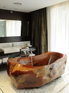 Hand carved bathtub made from fallen trees by artist Mario Dasso.