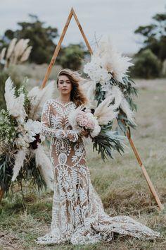 Little Love Story Triangle wedding arch / Peggy Saas Wedding Photographer / Rue De Seine Avril Gown for the Boho Bride / Botanica Naturalis pampas bouquet