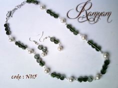 necklace made with glass bead and pearls with earring.