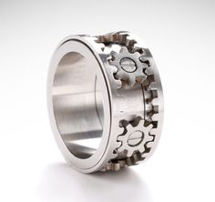 The patented Gear Ring is made from high quality matte stainless steel. It features micro-precision gears that turn in unison when the outer rims are spun (video below).