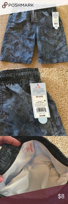 Cat & Jack Boys swim trunks !!Brand New!! Dark gray with a marbled design. These are brand new! Cat & Jack Swim Swim Trunks