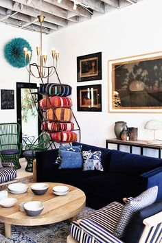 so much to love here - that chandelier, that midnight blue velvet, those floor pillows!