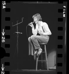 """uclalibraryspecialcollections: """" David Bowie, seated on stool during performance at the Universal Amphitheater in Los Angeles, California, 1974. Los Angeles Times Photographic Archives (Collection..."""
