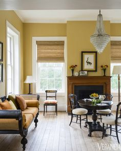 Antique cane sofa and chandelier; walls in Concord Ivory, Benjamin Moore