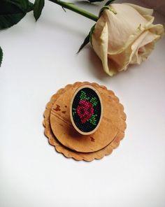 Wood: siberian birch plywood.  Fabric: black canvas 16ct.  Size: 6 * 45 *30 mm.  Weight: 5 g.  Fully handmade from Siberia. embroidery, cross stitch, petit point, wooden, flowers, rose, vintage rose, oval brooch, деревянные брошки, брошь из дерева, вышитая брошь, брошка с вышивкой, вышивка крестом, брошь с розой, вышивка роза, винтажная роза