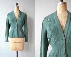 Vintage 1940s green German wool cardigan with floral embroidery, ribbed knit at the waist and metal buttons.  --- M E A S U R E M E N T S ---  fits like: medium/large shoulder: 18 bust: 38-42 waist: up to 34 length: 22 brand/maker: Bleyle condition: excellent  ➸ More tops & sweaters
