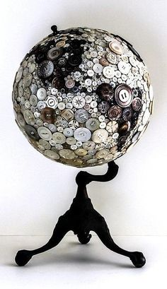 A handful of buttons of varying hue , size and designs would turn your old globe display into this !