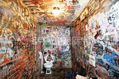 The graffitied bathroom walls of legendary punk rock club CBGB's are seen during the last month of its current lease August 10, 2005 in New York City. The club may have to close when its 12-year lease expires August 31 if a dispute with the landlord, Bowery Residents' Committee, is not resolved. (Photo by Scott Gries/Getty Images)  #punk
