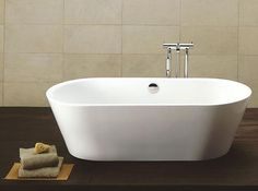 Google Image Result for http://www.femaleways.com/wp-content/uploads/2010/05/2-Minimalist-Freestanding-Bath-tubs-design-from-KASCH.jpg
