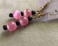 Check out 40% off Mothers Day Sale Sleek in Pink black Beaded Earring, drop earring, dangle earring, vintage earring, pink black earring, cats eye, pi on dawnsbeadsdesigns