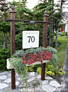 DIY house number sign including a flower box that myself & my husband came up with. DIY House number sign to go at the foot of the driveway. MoreDIY House number sign to go at the foot of the driveway. Outdoor Spaces, Outdoor Decor, Outdoor Ideas, Flower Boxes, Flower Basket, Outdoor Projects, Diy Projects, Yard Art, Curb Appeal