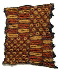 Africa | Ceremonial cloth from the Didi people of the Ivory Coast | The Dida do not sculpt, and consider their fabrics their prime treasures. Mostly used for ceremonial dances, the gauzy, vibrantly colored fabric is made of raffia palm fiber that is then tied and resist-dyed and re-dyed in a striking pattern of rectangles, ovals and circles. The palette of yellow, red and black is derived from plant roots, leaves and minerals | © Tim Hamill