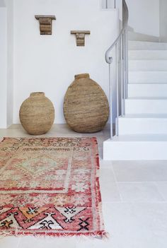 Moroccan Rugs make an inspired entryway A splash of colour in an otherwise neutral space. Available from tigmitrading.com