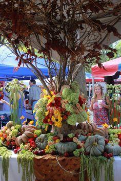 Tailgate Arrangement. Cinderella pumpkins, Hydrangea, Ranunculus, Fall Leaves, etc. Tailgate Tablescape, Football Flowers