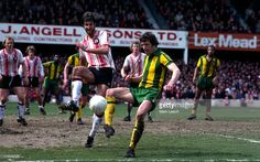 13 April 1979. The battle of two old fashioned defenders. Southampton's Chris Nicholl attempting to tackle West Brom captain John Wile.