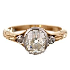 Antique Oval Cut Diamond Platinum & Yellow Gold Engagement Ring | From a unique collection of vintage three-stone rings at http://www.1stdibs.com/jewelry/rings/three-stone-rings/