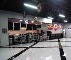 Amazing garage as voted Car Collector Magazine, with Moduline aluminum cabinets and counter tops.