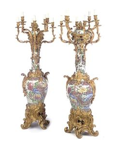 A pair of large Louis XV style ormolu-mounted Famille Rose and Famille Verte porcelain eight-light candelabra<br>The covers Kangxi period (1662-1722), the necks Samson, 19th century, the jars Chinese, 18th century, the ormolu third quarter 19th century<br>Each with bulbous cover with pine-cone finial, the waisted neck issuing eight scrolling arms each terminating with a foliate drip-pan and circular nozzle, the bulbous body flanked by scrolling foliate handles, on scrolling acanthus-cast ...