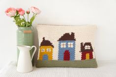 Crochet your own House Cushion!  This delightful cushion is easy to make with full instructions including a colour change graph. With a buttoned opening on the back to take the pad in or out for washing. Ideal to brighten up any seat or room and great to make for a gift! **Included in the Instant Download are both the English and American versions of this pattern**  Make this cushion to match the Home cushion also found in the Little Doolally Etsy shop!  Finished dimensions; 17 x 13…