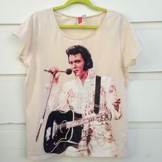 H&M Elvis t-shirt. H&M Elvis t-shirt. 100% cotton. Size 12. Worn once, good condition. Best offer. H&M Tops Tees - Short Sleeve