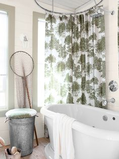Country Living - 2012 House of the Year: Guest Bedroom Cottage  Thomas brought the outdoors in with his Tree fabric sewn into a custom-made shower curtain and created a double-duty hamper/stool in a small bathroom.