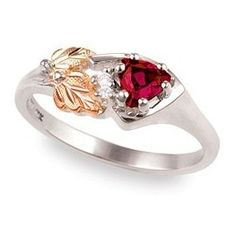 Sterling Silver and BHG CZ and Gemstone Ring    Metal: Sterling shank with 12k red and green leaves.  Center Stone: 5.0mm created trillion with two 1.5mm white CZ.  Made in USA