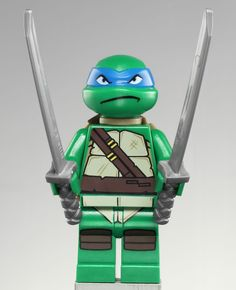 Leonardo is a Teenage Mutant Ninja Turtles minifigure first released in 2013. He is the leader among the four turtles. Leonardo's head is a new mould made for the turtles. It is dark green with a blue bandana around it. In 79104 The Shellraiser Street Chase he has an angry expression in which his teeth are bared and clenched, but in 79103 Turtle Lair Attack he is frowning. He wears a new turtle shell piece made exclusively for the Teenage Mutant Ninja Turtles line. It is khaki, has a turt...