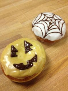 Halloween doughnuts!  Pumkin glazed jack-o-lantern with pumpkin cheesecake filling, and chocolate pudding filled web doughnuts with vanilla glaze  #Charleston #SC #donut