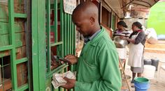 """A """"mobile money"""" revolution has swept Kenya, where people can send and receive money on their cell phones. It's improved commerce and brought basic necessities to poorer areas"""