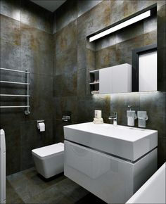 Everything else remains sleek and ultra-modern. These white fixtures easily stand out against their dark background.