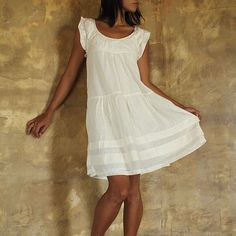 Sweet and simple summer dress.  Add a plain pair of strappy leather sandals, and a few bangles and were set!
