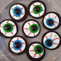 OREO Cookie Eyeballs – A Halloween Treat DIY. If I used purple skittles instead of M&M's or Reeses pieces Matthew could eat them.