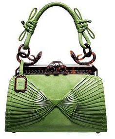 A favorite from the Fall 2007 collection, Dior's  samourai 1947 bag in green suede features pleated leather on the front side, and  turtle shell clasp