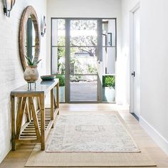 BECKI OWENS- 7 Elements of the Modern Farmhouse. Entry with painted white brick wall, steel frame door, vintage kilim rug and rustic woods. Studio Mcgee, Farmhouse Design, Modern Farmhouse, Farmhouse Style, Farmhouse Decor, Steel Frame Doors, Have A Great Night, Entry Tables, Entry Way Design
