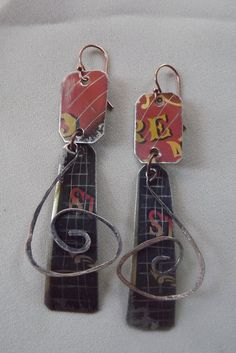Recycled Vintage Tin Buffalo Gal Goes West Spiral Dangle Earrings. $38.00, via Etsy.