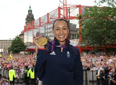 Still smiling: Ennis beams with pride while showing off her Olympic handiwork in front of the crowd in Sheffield city centre