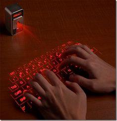Cool neonová klávesnice ktérá je bez drátu a místo tlačítek ťukám do stolu nebo kde ta klávesnice je