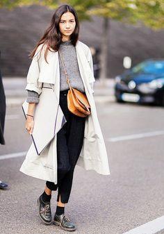 White coat + grey sweater + black pants + tan bag + black loafer shoes