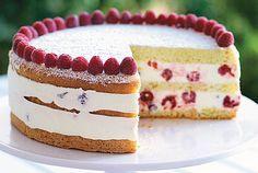 Raspberry Lemon Cream Cake: Tender sponge cake holds layers of fresh raspberries in a creamy lemon filling for this make-ahead dessert.