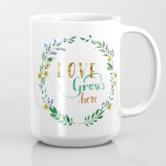 """""""Love grows here"""" by tanjica Blue and yellow flowers and leaves in a wreath with handwritten calligraphy in watercolor technique for all garden and nature lovers. Simple but effective, elegant and sophisticated hand painted watercolor artwork. metal print for garden, garden sign, horticulture, vegetation, botanical, leaves, branches, greenery, green, foliage, gardening, gift for a gardener, calligraphy, gold letters, watercolor brush lettering, aquarelle, watercolors, original art"""