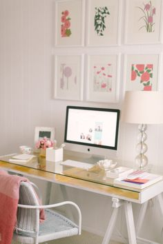 Great placement of the frames above the desk, simple but pretty lamp, and the idea to store odds and ends under the glass top of a desk like this while still maintaining a nice working space // Style Me Pretty