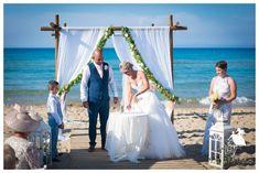 Emma and Dean's pretty beach wedding and garden style reception in Zakynthos, love the detail, lots of gorgeous inspiration and ideas here #weddinginzante #zante #zakynthos #lemon #yellow #roses #beach #vintage #gold #seaview #gardenreception