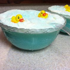 Baby Shower Punch (for a boy) - 1 bottle white grape juice,   1 bottle 7up,   1/2 bottle of blue hiwaian punch,    8 scoops of vanilla ice cream:    Mix all juice and punch together in a large punch bowl and then add ice cream. Next pour the 7up over the ice cream and serve.