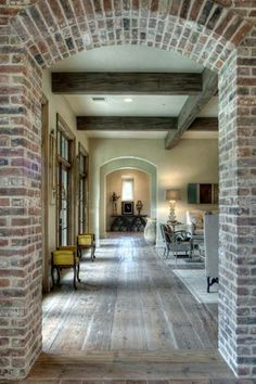 Love everything about this! Floors, ceiling beams, brick...