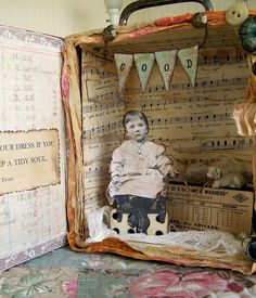 cigar box art -- love the layered look and the use of sheet music