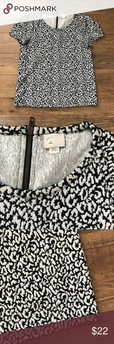 Postage Stamp Anthropologie Top Black and white animal print top in size small. Zipper down top of back. Short sleeves. Anthropologie Tops