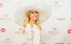 And they're off…the stars trotted out in their Sunday best for the 2014 Kentucky Derby at Churchill  White out  Broadway star, Laura Bell Bundy, arrived at Churchill Downs wearing her summer whites. Opting for a floral lace long sleeve dress, Bundy chose an optically bright petal hat