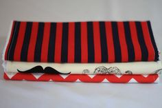 Set of three burp cloths, one mustache, one navy/red striped and one red chevron $15